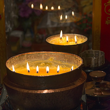 Flames burning in a row in large bronze pots, Lhasa xizang china