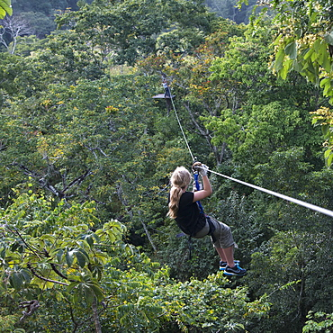A Girl Riding A Zip Line, Copan, Honduras