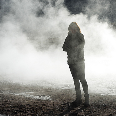 A Woman Stands In The Steam Of A Geyser, El Tatio Geysers, Calama, Antofagasta Region, Chile
