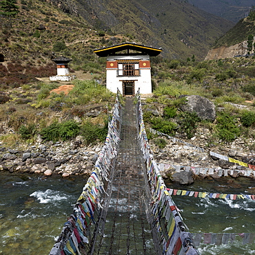 Suspension Bridge Made From Wood And Chain Across Paro River, Near Tachog Lhakhang Dzong, Paro, Bhutan