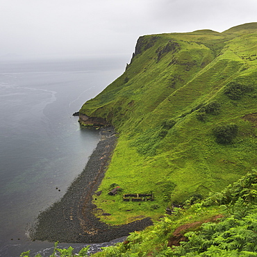 Fog Over The Ocean And Lush Foliage Covered Slopes Along The Coast, Lealt Falls Canyon, Portree, Scotland