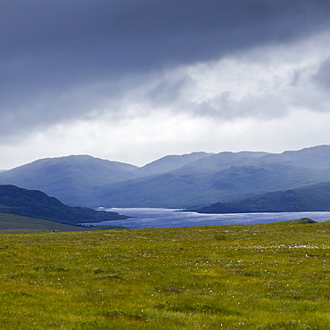 Storm Clouds And Fog Over The Mountainous Landscape And Water In The Highlands, Scotland