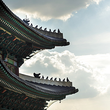 Detailed Roofline Of Gyeongbokgung Palace Against A Blue Sky With Cloud, Seoul, South Korea