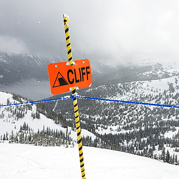 A Caution Sign At A Ski Resort Warning Of A Cliff, Whistler, British Columbia, Canada