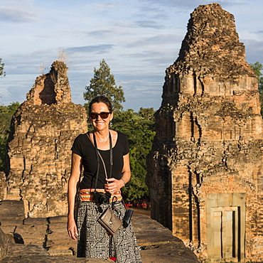 A Woman Stands Posing For The Camera At Pre Roup Temple, Krong Siem Reap, Siem Reap Province, Cambodia