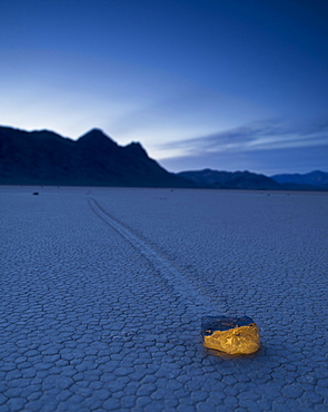 A Rock Formation Glowing On The Arid Ground In The Mojave Desert; Death Valley California United States Of America