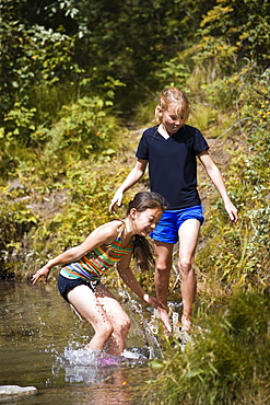 Two Girls Playing In Water