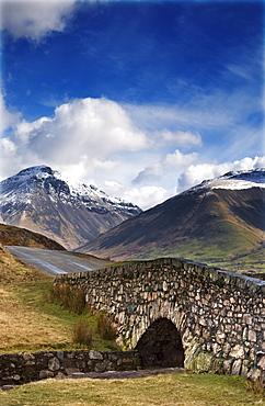 Stone Bridge In Mountain Landscape, Lake District, Cumbria, England, United Kingdom