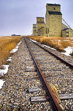 Grain Elevators Along Train Tacks, Alberta, Canada