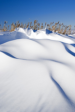 Snow Drifts On A Hill