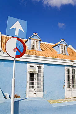 Blue Building With Sign Outside