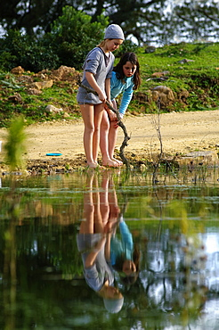 Two Girls Exploring In The Water