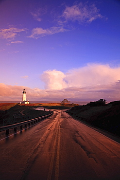 A Road And A Lighthouse Along The Coast