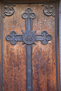 Buenos Aires, Argentina, A Metal Cross On A Wooden Door Of A Tomb In Recoleta Cemetery
