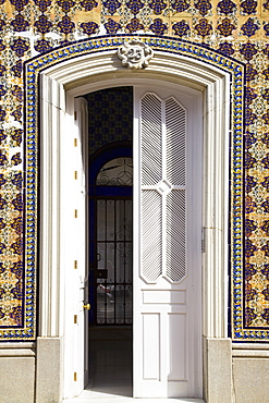 Chiclana, Andalusia, Spain, A White Door In A Colorful Wall