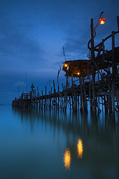 Lights On A Wooden Pier Leading Out In The Water At Night, Kho Samet, Thailand