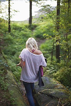 Girl Walking Through The Forest To The Lake, Kristiansand, Norway