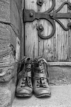 A Pair Of Worn Boots Outside A Door, Northumberland, England