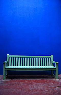 A painted green bench along a blue wall, Marrakech, morocco
