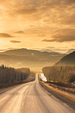 Sunrise over the alaska highway west of fort nelson, in the canadian rockies in early spring, British columbia, canada