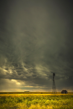 Mammatus storm clouds above a windmill on the saskatchewan prairies, Saskatchewan, canada