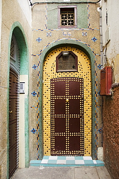 Uniquely decorated door with an arch and a design on the facade of the house, Casablanca morocco