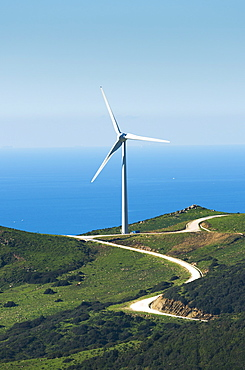A wind turbine along the water's edge, Tarifa cadiz andalusia spain
