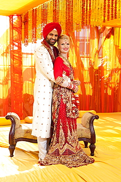 Portrait Of A Mixed Race Couple On Their Wedding Day In Traditional Indian Garments For A Wedding, Ludhiana, Punjab, India