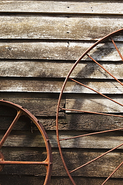Old Wagon Wheels Against A Wooden Wall, Margaret River, West Australia, Australia