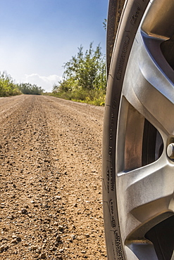 Close Up Of A Tire On A Dirt Road, Fort Mckay, Alberta, Canada