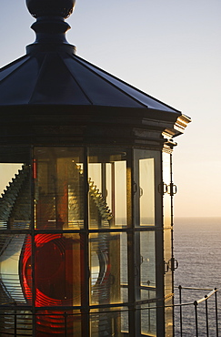 The Sun Sets At Cape Meares Lighthouse, Oregon, United States Of America