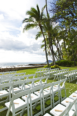 Chairs Set Up For An Outdoor Wedding At The Water's Edge With A View Of The Ocean, Honolulu, Oahu, Hawaii, United States Of America