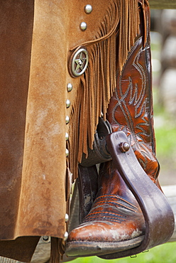 Close-Up Of A Cowboy Boot In The Stirrups, Alberta, Canada