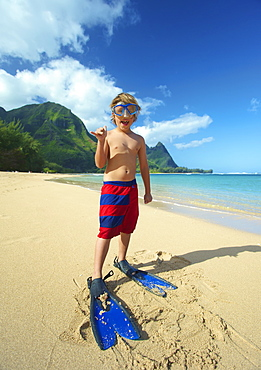 A Boy On The Beach With Snorkelling Gear, Kauai, Hawaii, United States Of America