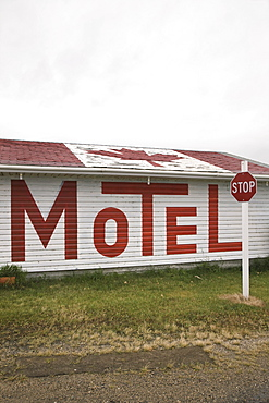 A Motel With The Sign Written In Large Letters On The Side Of The Building And A Canadian Flag On The Roof, Broadview, Saskatchewan, Canada