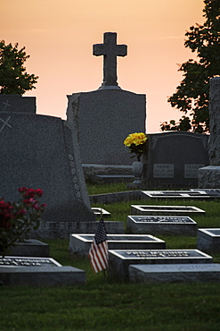 Tombstones In A Cemetery At Sunset, Ohio, United States Of America