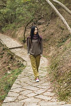 Young Woman Walking On A Trail, Xiamen, China
