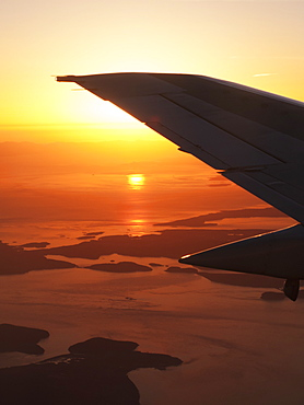 Silhouette Of Airplane Tail In Flight At Sunset, British Columbia, Canada