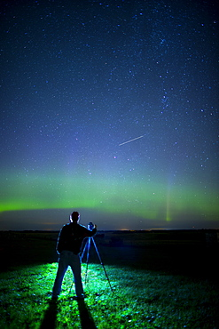 A Photographer Captures The Northern Lights And Shooting Star, Near Edmonton, Alberta Canada