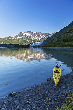 Kayak On The Beach With Shoup Glacier Spilling Over The Chugach Mountains Into Shoup Bay, Shoup Bay State Marine Park, Prince William Sound, Valdez, Alaska, United States Of America