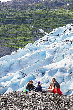 Couple With Daughter Having A Snack Overlooking A Glacier, Shoup Bay State Marine Park, Prince William Sound, Valdez, Alaska, United States Of America