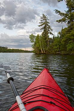 Kayaking In A Tranquil Lake At Sunset, Ontario, Canada