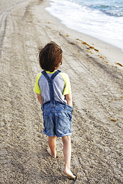 Young Boy Walking On The Beach, Hollywood, Florida, United States Of America