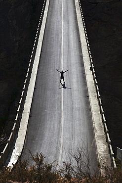 Silhouette Of Man On High Bridge, Lijiang, Yunnan Province, China