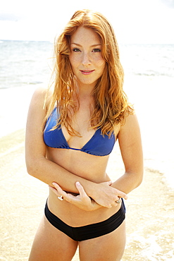 Hawaii, A Redheaded Girl In A Swimsuit.