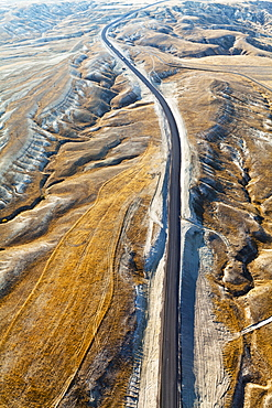 Aerial View Of A Road Through A Rugged, Barren Landscape, Cappadocia, Turkey