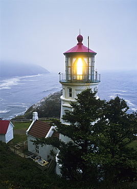 The Heceta Head Lighthouse Flashes On A Foggy Morning, Florence, Oregon, United States Of America