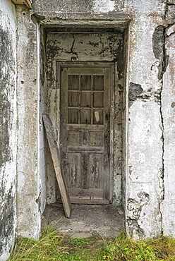 An Old Door In An Abandoned Building In An Old Fishing Village, Djupavik, Iceland