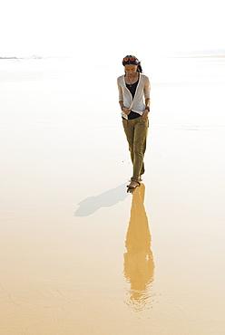 Young Woman Walking On The Beach From Huohu, North Of Kinmen Island, Taiwan
