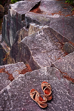Sandals Sitting On A Rock Ledge, Vancouver, British Columbia, Canada